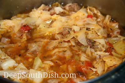 Cajun Cabbage Stew - a stew of ground beef, andouille sausage, cabbage, onions, bell pepper, celery, potatoes and carrots in a beefy broth with Rotel tomatoes.