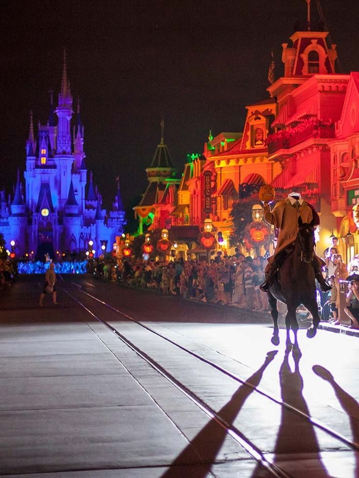 AT MNNSHP the headless horsemen rides down the street before Mickey's Boo to You parade. - Disney Halloween
