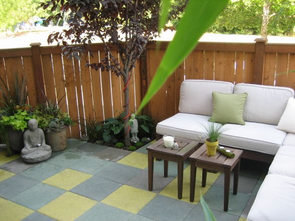 Captivating Patio Oasis, Small Townhouse Backyard Turned Into An Outdoor Living Space  Using Custom Stained Cement Pavers, Potted Plants, And Comfortable Stylisu2026