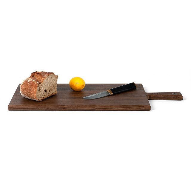 Cheese Paddle No.5 in smoked oak - While many owners treat their Cheese Paddles very gently, the materials used in these cheese boards can withstand a lot of wear and tear. We encourage owners to use their cheese boards as everyday chopping boards as well as handy serving trays.