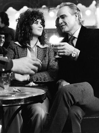 Marlon Brando and Maria Schneider drinking on the set of Last Tango in Paris