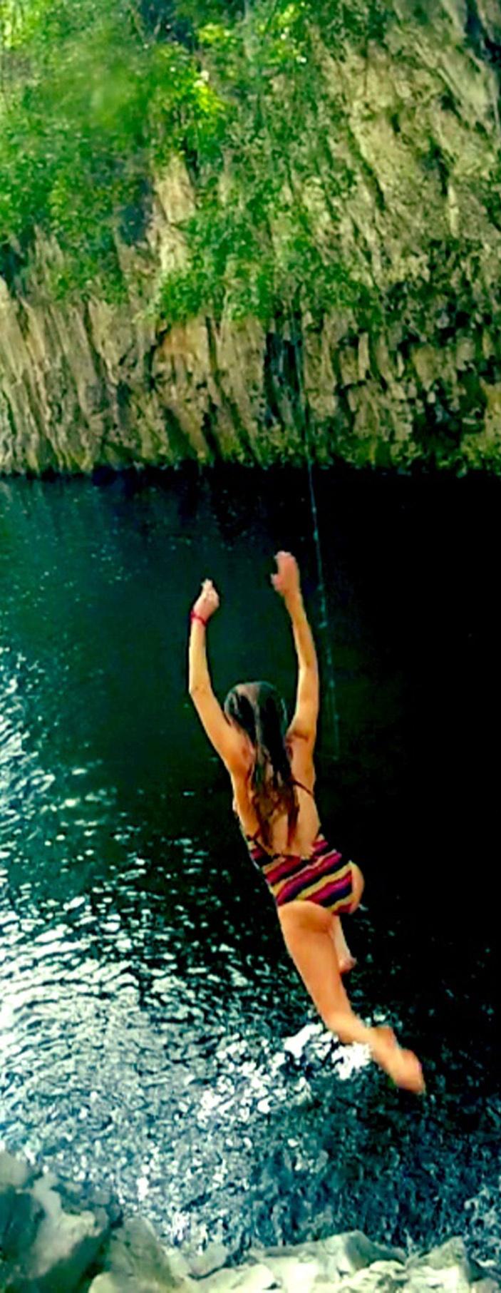 Monyca Byrne Wickey taking a leap in her Lapped Swimsuit shot on her @GoPro #ROXYOutdoorFitness
