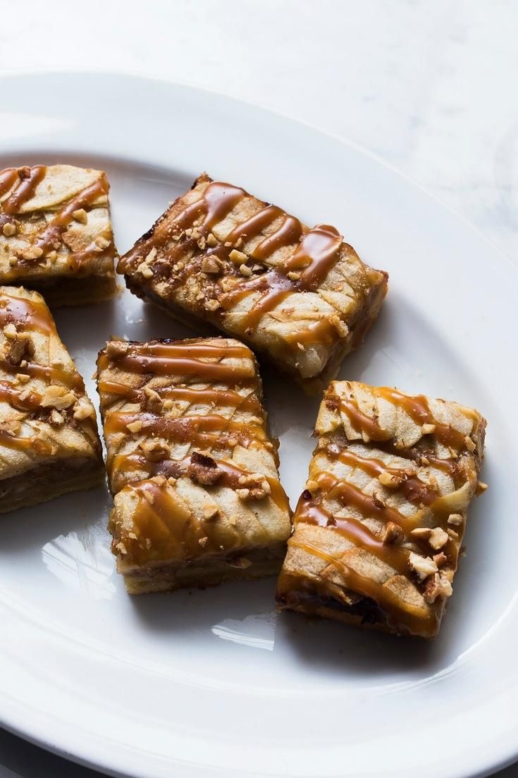 Apple pie bars smothered in Patrón XO Cafe Incendio salted caramel are proof heaven is real.