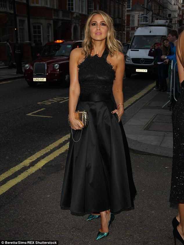 Classic: She shrugged off the controversy and stepped out looking sophisticated in black...