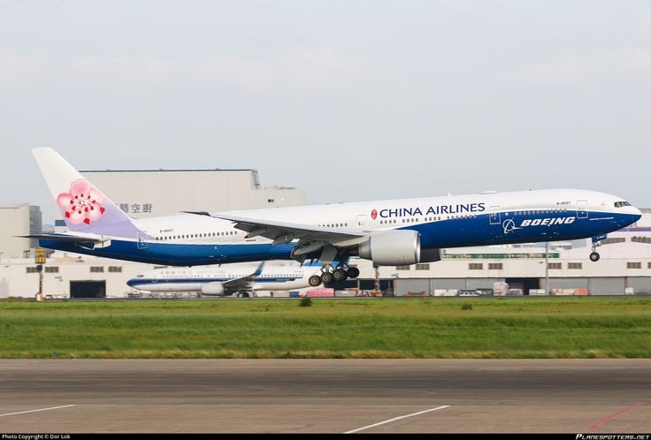 China Airlines (TW) Boeing 777-309(ER) B-18007 aircraft, painted in ''Boeing'' special colours, landing at Taiwan Taipei Taoyuan International Airport.  16/06/2016.