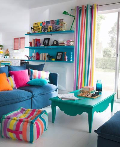 Decorating a white living room with vivid colors and rainbow stripes