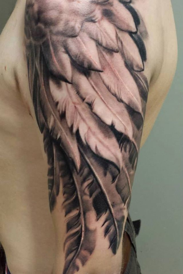 Grey Ink Feather Wings Tattoo On Half Sleeve