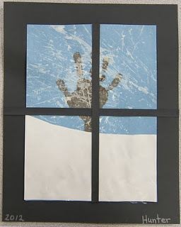 wintry tree...hand print, white snow and a black construction paper frame!