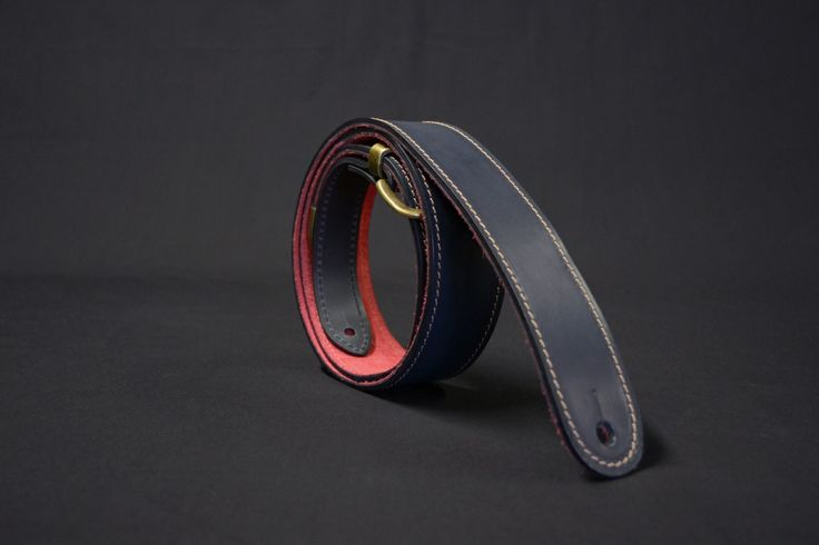 "Ravens Tor Leather Guitar Strap in Navy with Chili Red suede lining. 2"" wide tapering down to 11/4"" London Wire buckle."