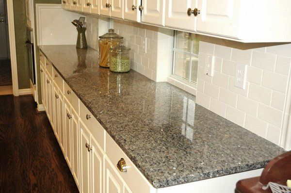 white kitchen cabinets new caledonia granite countertop subway tile backsplash wood flooring                                                                                                                                                      More