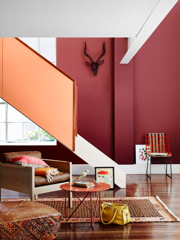 Earthy red and orange add warmth and a dynamic energy to this living area.  Photo credit: dulux.com