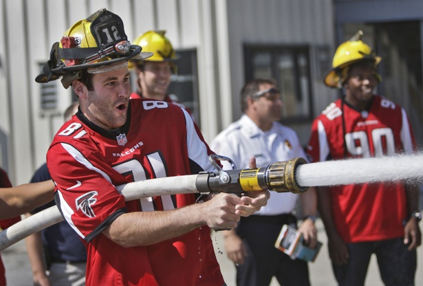 Michael Palmer 81 Falcons Team members thank firefighters for service