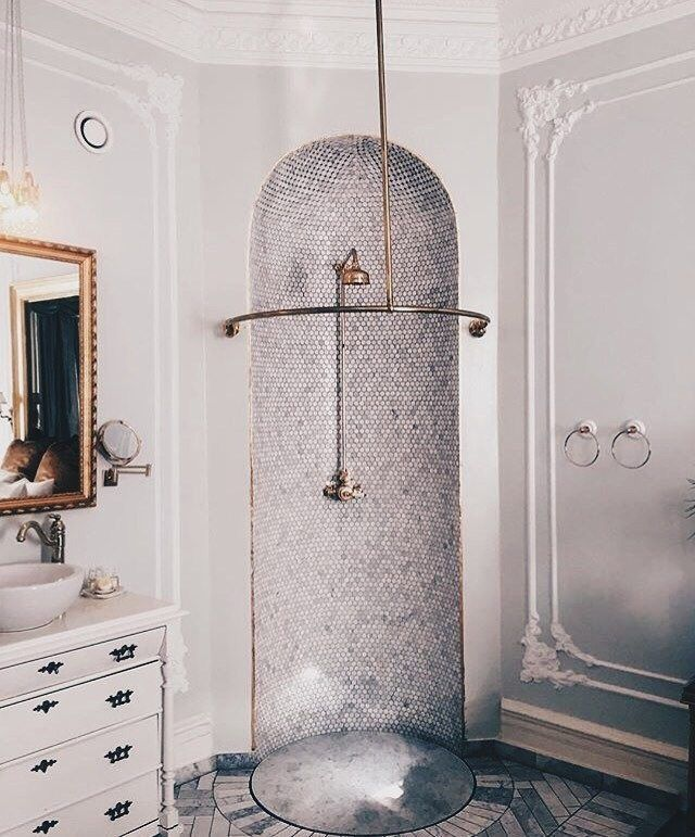open showers | bathroom | tile | old fashioned | master bath | vintage | brass fixings