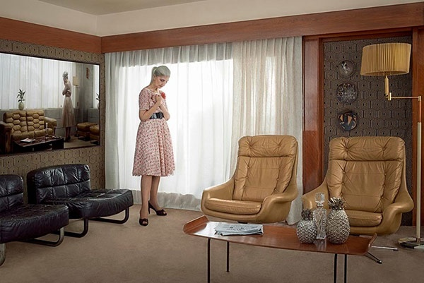 Erwin Olaf: enigmatic portrait of person in their mid century modern living room