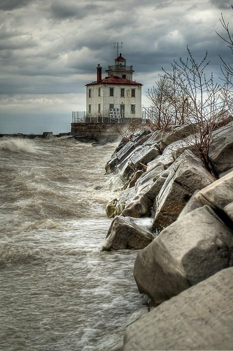 """Light in the Storm 2"" - - Headlands Beach and Lighthouse at Headlands Beach State Park on Lake Erie in Ohio. The clouds were very dark and the weather was ominous but occasionally there times when it lightened up a bit."