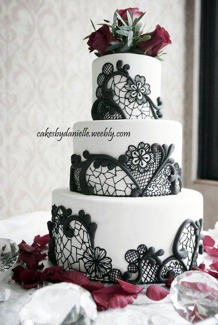 Black, Red & White Wedding Cake by CBD. I think I would prefer to exchange the flowers for red ones