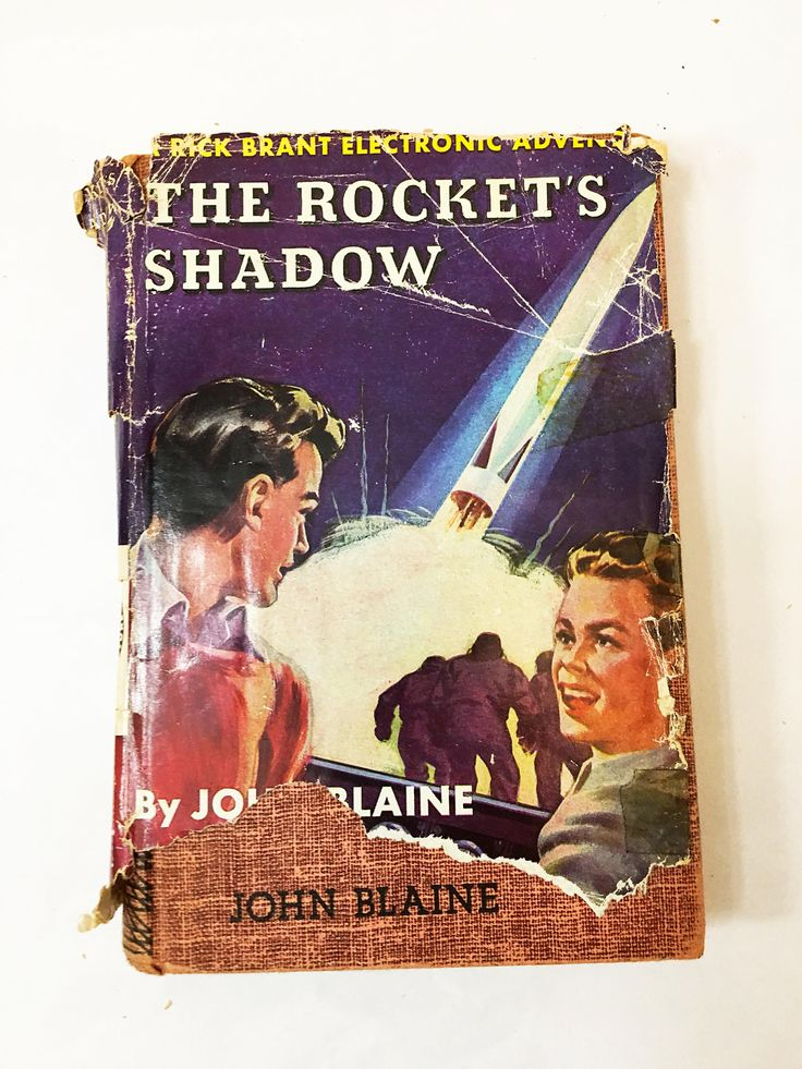 The Rocket's Shadow Book. Volume 1. Rick Brant Electronic Adventure Book w dust jacket. Early print circa 1947. John Blaine. Red Binding
