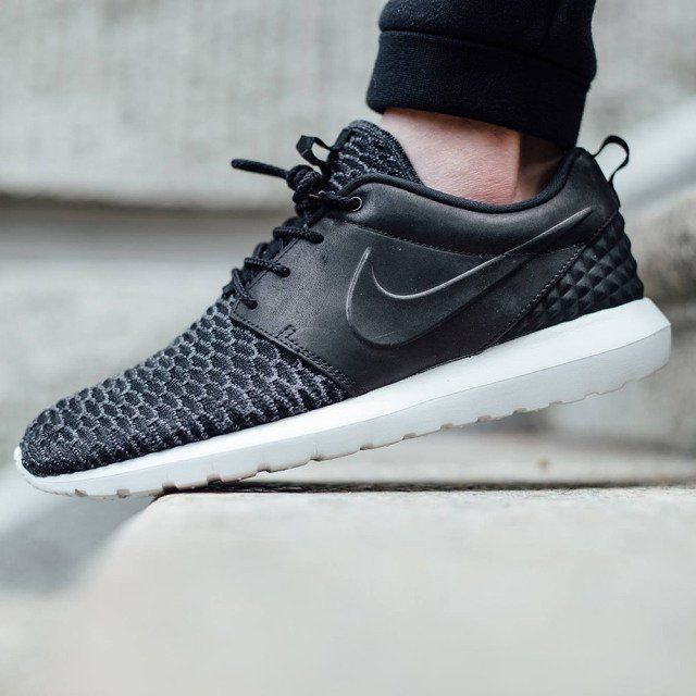 Nike Roshe Run Flyknit Black Sneakers Low-top sneakers Round toe Laced shoe  Rubber sole Fabric interior Logo on underside of sole Logo on the side Logo  on ...