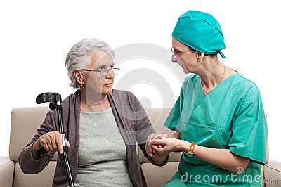 Nurse tending an old woman. Disabled senior lady with crutch hand in hand with a carer. Isolated on white.
