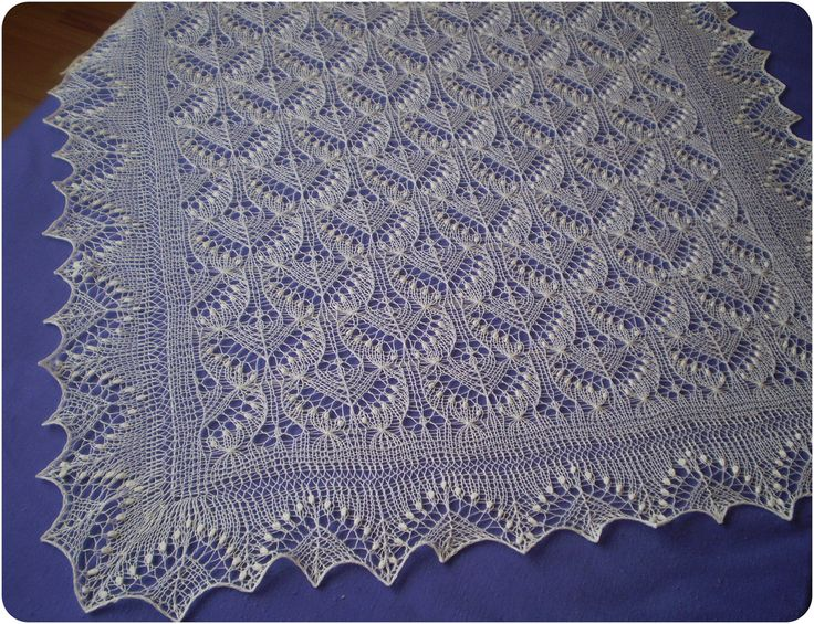 Hand knitted shawl.