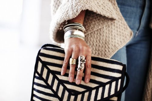 love the whole thing, from the bell sleeves to the rings to the handbag.