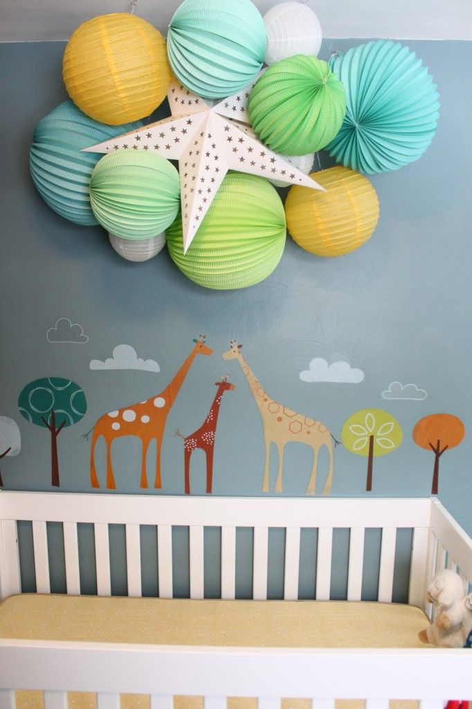 Fun paper lanterns and animal decals are so cute in this #nursery.   #blue #green #paperlantern