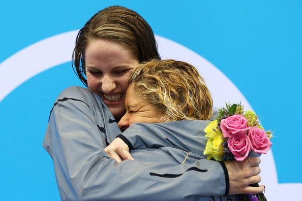 Gold medalist Missy Franklin of the United States and bronze medalist Elizabeth Beisel of the United States embrace on the podium during the medal ceremony for the Women's 200m Backstroke Final on Day 7 of the London 2012 Olympic Games at the Aquatics Centre on August 3, 2012 in London, England.