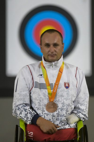 Bronze medalist Peter Kinik of Slovakia celebrates on the podium at the medal ceremony for the Menâs Archery Individual W1 Final during day 9 of the Rio 2016 Paralympic Games at Sambodromo on September 16, 2016 in Rio de Janeiro, Brazil.