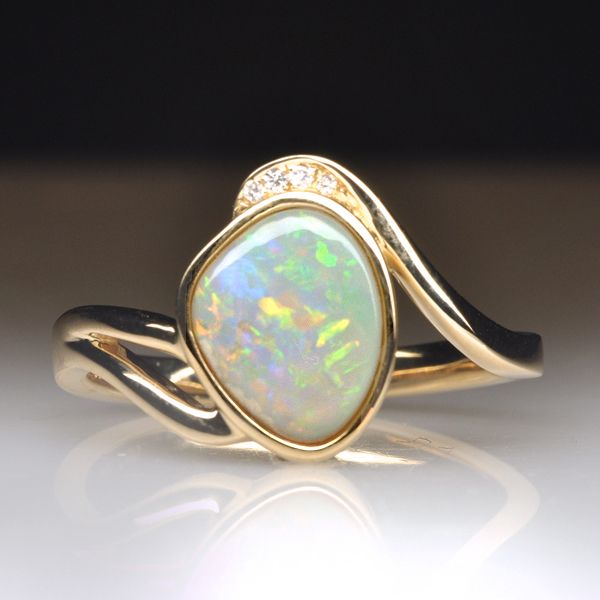 Choose natural solid light opal gold ring. It  has wonderful colours and excellent Brilliance.