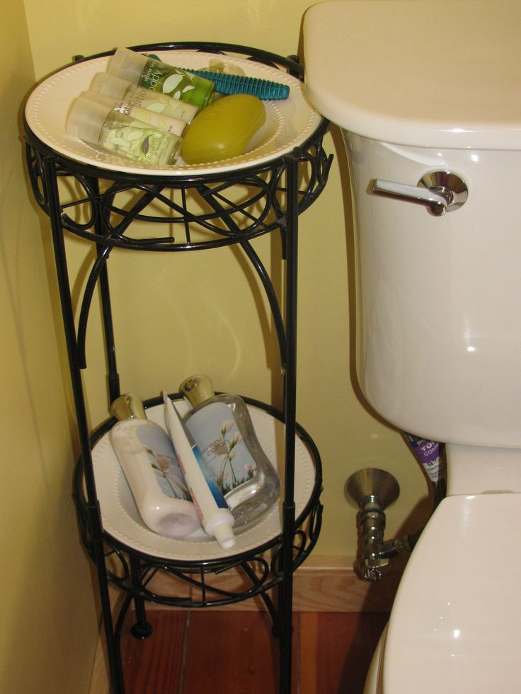 plant stand w/ dollar store bowls wouldnt want it next to my toilet but cute idea for hairbows and stuff