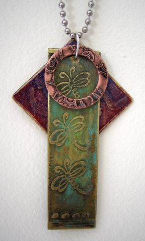 three metal shapes; alcohol inks for pendant