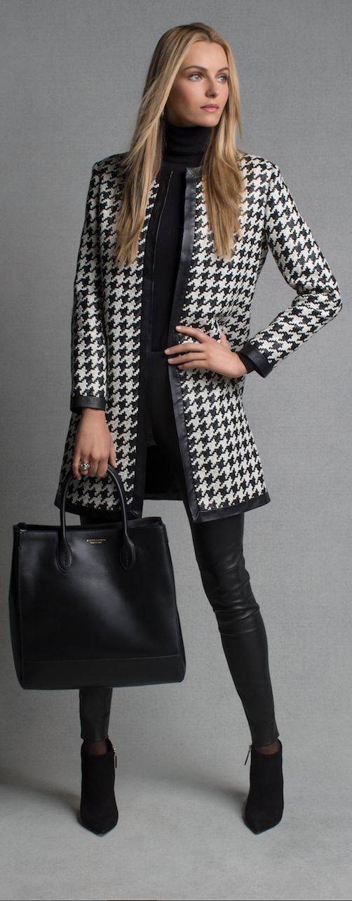 Black and white houndstooth coat: Strips of supple lambskin woven into a stunning houndstooth pattern gives our Adelle Coat an air of sophisticated luxury. Make this knee-length topper the centerpiece of your look by combining it with a black turtleneck and a leather skinny pant.