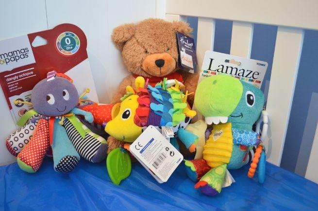 Baby Girl Nursery - Lamaze toys in cot bed