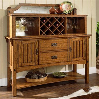 Craftsman Server with Hutch  This Mission style collection is accomplished in oak solids and veneers with walnut diamond inlay accents and authentic mission hardware throughout.   	Constructed of hardwood solids with veneers 	Medium brown oak finish 	Two drawers and two doors with one adjustable shelf behind each, plus an open shelf below 	Built-in wine bottle rack and stemware holder 	Antique brass hardware 	Dry/damp cloth only on furniture, no oil based cleaners