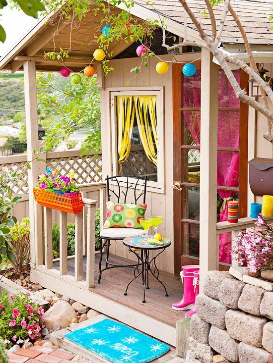 Love it,so colorful and fun! This is now officially my inspiration for decorating the outdoor playhouse for the kids that Greg is almost finished with! The paper lantern lights, the bright curtains, and that planter looks like a floating shelf with popsicle sticks added to it to look like a picket fence...I wonder if I did that if it would hold light small pots...hmm