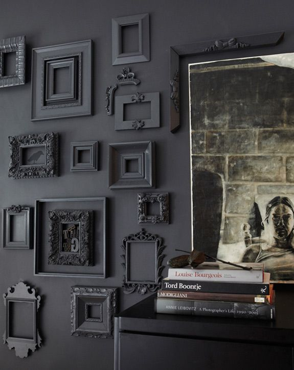 black frames on a black wall, bird stencil in one, letters in another, some partial frames, very cool, would be great in a guest bath