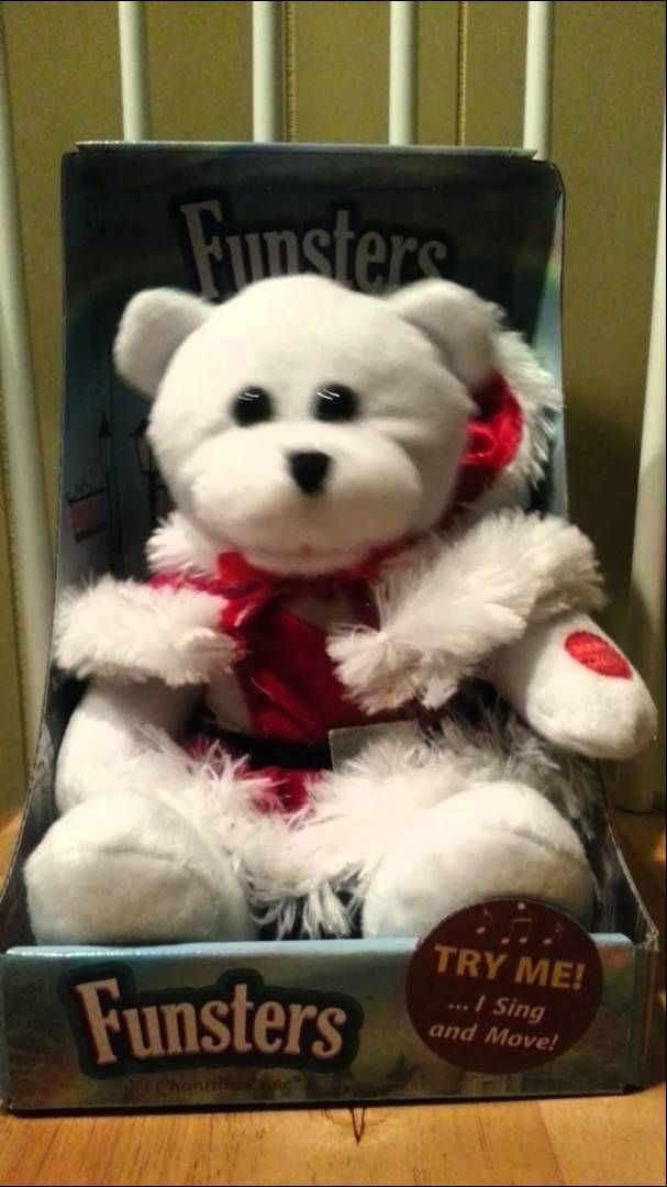 Adorable plush animal sings Santa Baby !