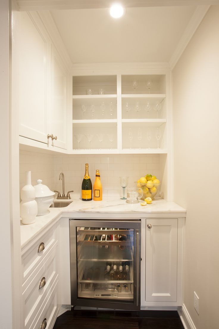 A Butler's Pantry with a wine fridge inside? Yes please! The perfect area to get drinks ready for a party.
