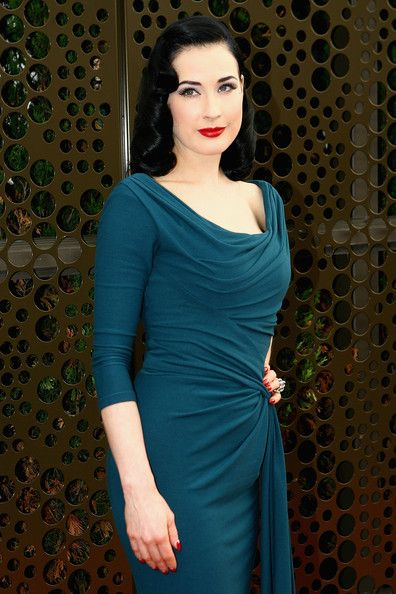 Wow. Gotta  love the draping! Dita von Teese dress-make me think of my mother in her young days from pictures i have seen