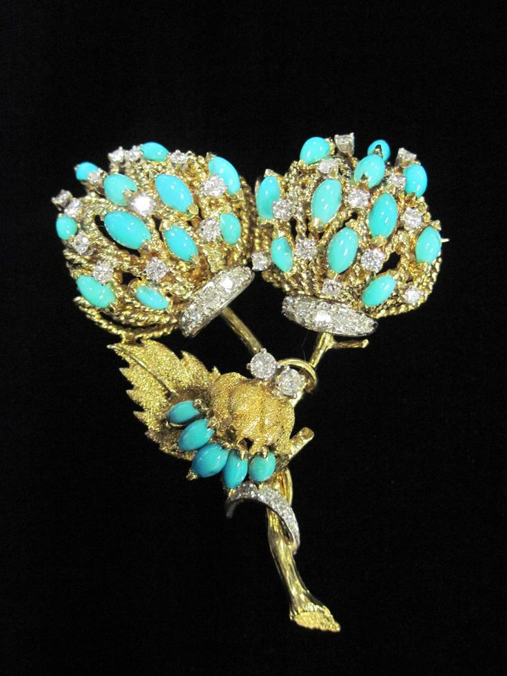 A diamond, turquoise and eighteen karat gold pendant brooch foliate motif set with marquise cabochon turquoise and round brilliant-cut diamonds; total diamond weight approximately: 1.20 carats.