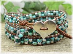 LEATHER WRAP BRACELET/ SEED BEAD LEATHER WRAP BRACELET/ BEADED LEATHER WRAP/ BOHO WRAP BRACELET/ SEED BEAD BRACELET/ BEADED WRAP BRACELET. THIS LEATHER BRACELET IS MADE TO WRAP AROUND YOUR WRIST 3 TIMES YOU HAVE YOUR CHOICE OF MANY BUTTONS. IF THERES AN ITEM WITH A PARTICULAR