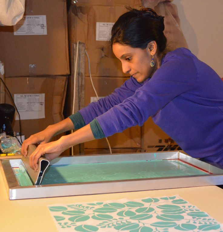 Screen printing my leaf print design, using a hand cut stencil that I designed