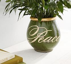 See if I can paint words on a plant pot for the living room. Colours: blue, green, brown. gold, yellow.