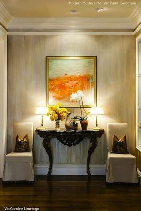 An elegant accent wall finished in a striae finish using Modern Masters Metallic Paints | By Caroline Lizarraga | Modern Masters Cafe