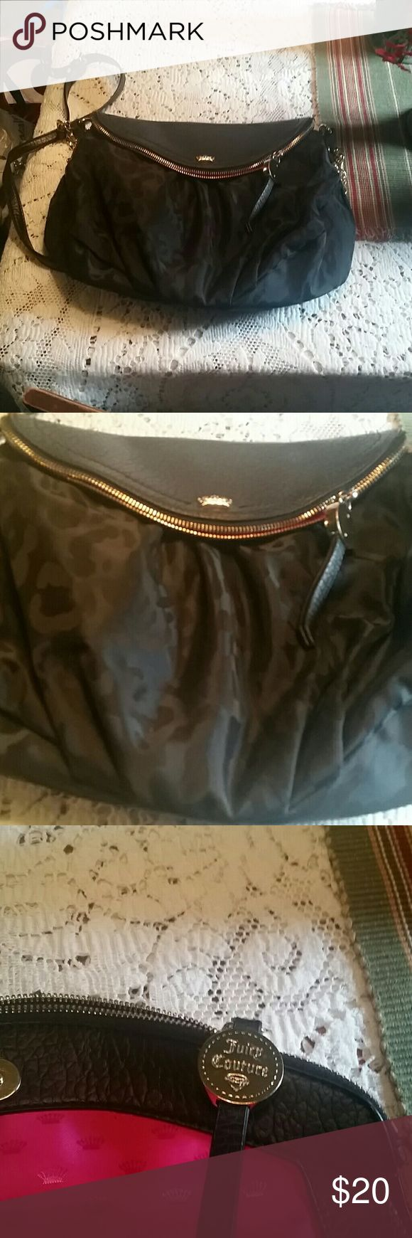 Women's handbags Black with  fabric print outside.  The fold over flap is poly the lining is pink satin (nwot ) the flap has zipper pocket Juicy Couture Bags