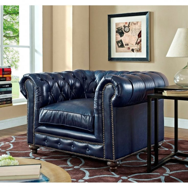 A truly classy and handsome piece of furniture, this completely handmade chair will bring your man cave to the next level. The nail head trim and button tufting along the back and arms are all individually hand applied for top quality and impeccable detail. Reclaimed oak legs and a kiln-dried wood frame promise durability, while hand-tied spring tension and 50% feather down padding ensure luxury and comfort.