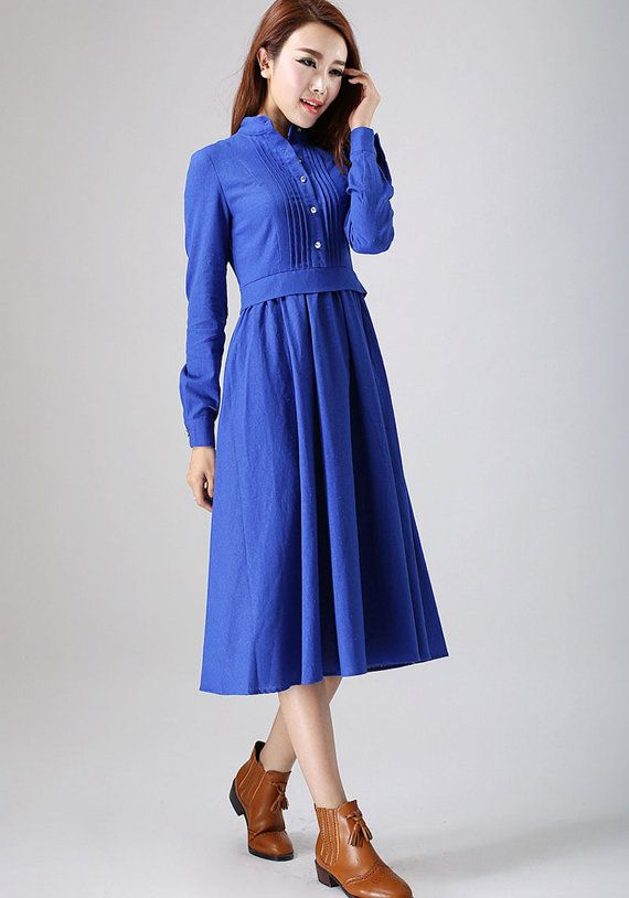 Details:  * Made from good blue linen * Blue midi dress  * Pleated in the front * Buttons in the front side and sleeve  * Long sleeves  * Right zip