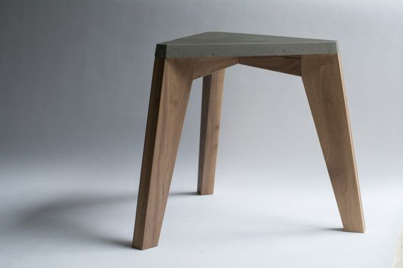 Our Tri-Stool is a stylish piece can be used as a stationary seat or a nice side table to compliment any living interior. The concrete top is an equilateral triangle made using high-strength concrete for crack-resistance. Legs are made using solid walnut wood. (other woods available upon request) Materials and finish: Concrete / Walnut wood Product dimensions: -18 (total width) -15 (seat width) -18 (height) -Made to order (please allow 2-3 before shipping) NOTICE: -Sales are final 3 da...