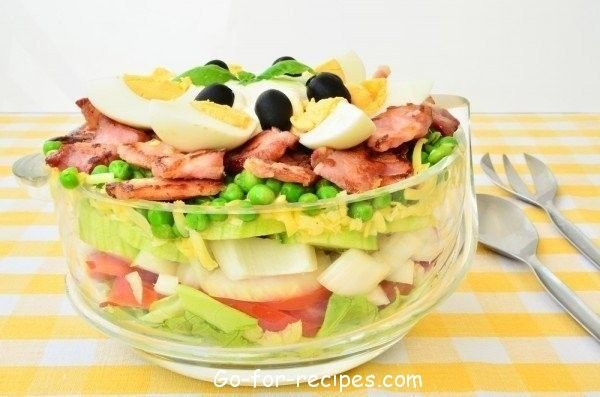 Layered salad with bacon and green peas