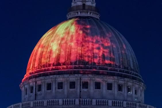 The iconic dome of St Paul's Cathedral was last night illuminated with a fiery…